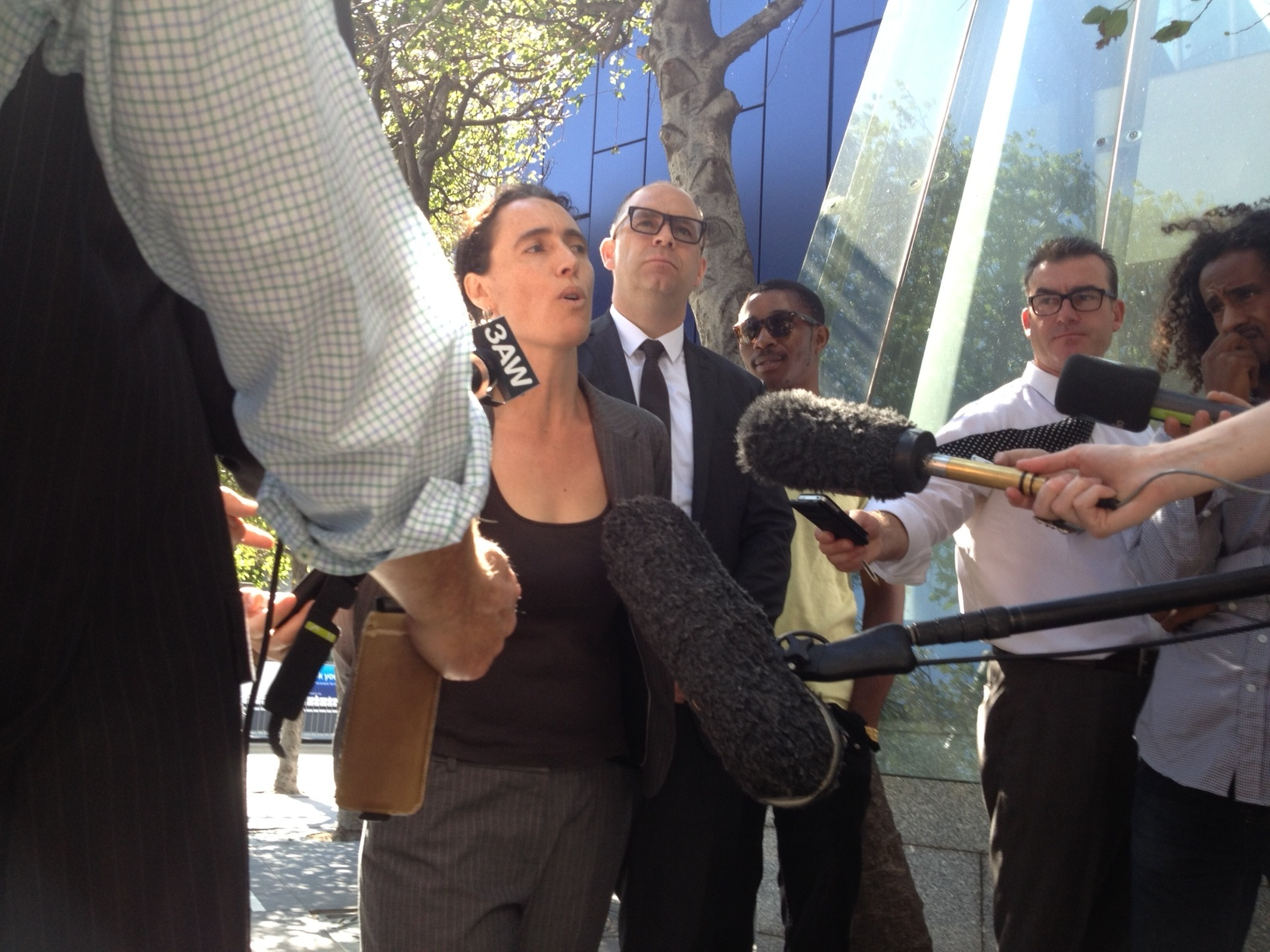 Photo: Anthony Kelly.   Tamar Hopkins speaking at a media conference outside the Federal Court February 2013