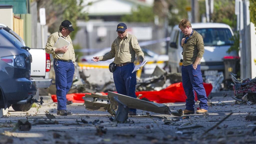 Australian Transport Safety Bureau investigators scour the wreckage of a light plane crash in Chelsea. Picture: Eugene Hyland