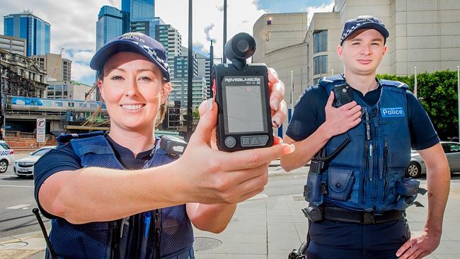 A Policewomen hoplding up a camera