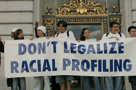 Group pf people holing banner that reads - Dont Legalise Racial Profiling